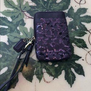 Dark purple sequin coach wristlet.  Super cute!